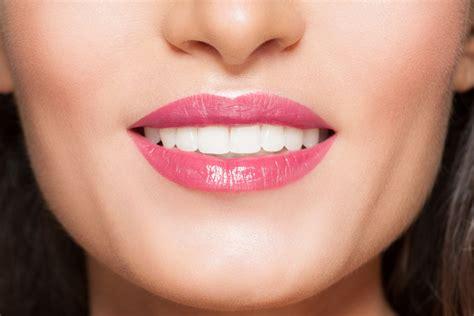 Reasons To Smile: Immigrants Show More Positive Facial Expressions To Overcome Language Barrier