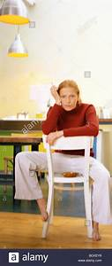 Young woman sitting backwards on chair smoking Stock Photo ...