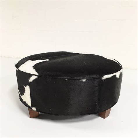 black and white ottoman round ottoman in black and white brazilian cowhide at 1stdibs