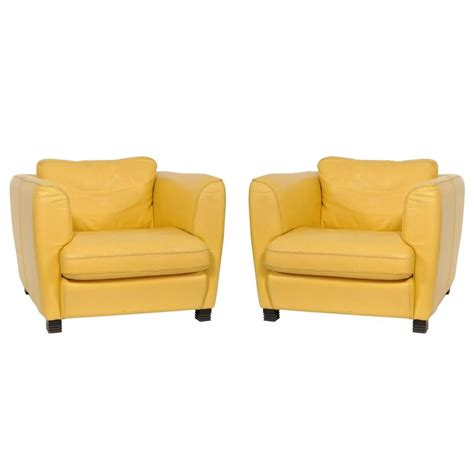 pair of 1960s yellow leather club chairs at