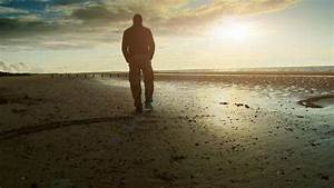 Man alone, walking along the beach at sunset - Stock Video ...