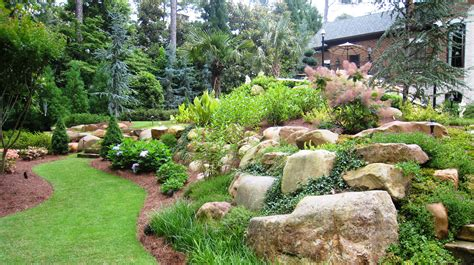 using boulders in landscaping large natural boulders combined with shrubs and perennials yard pinterest shrub