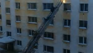Incredible moment Russian firefighter is knocked down ...