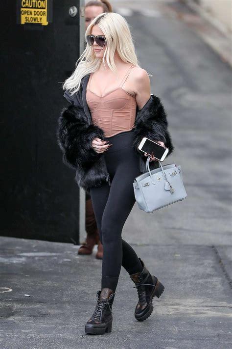 khloe kardashian leaves a studio wearing a pink top and ...