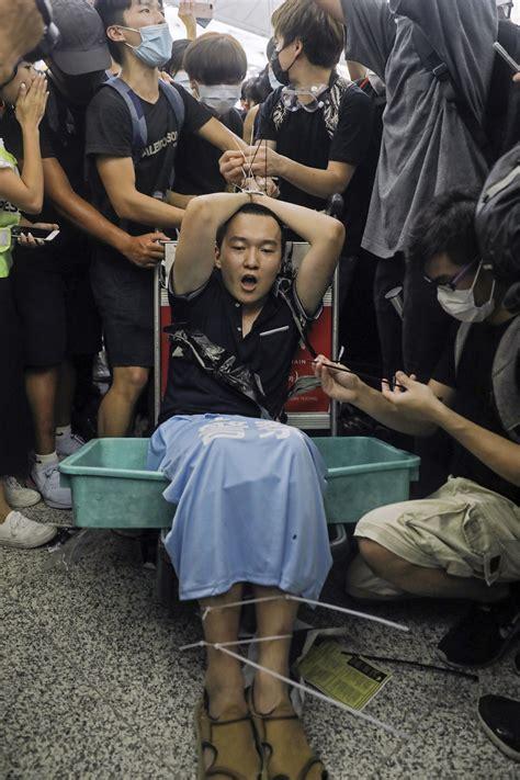 mob violence marks  day  protests  hong kong airport inquirer news