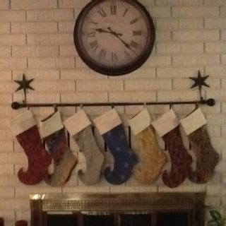 hooks for stockings on brick found a way to hang the without a mantle brick hooks and a curtain rod made