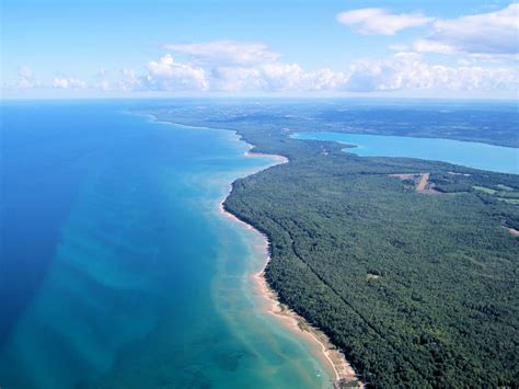 As the state's longest and second largest inland lake, torch lake is a favorite destination for fishing, boating, and relaxing near the shore. Photographic Logbook: The Flying Bear Visits Sleeping Bear ...