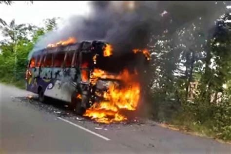 video andhra bus catches fire  road  passengers  narrow escape  news minute