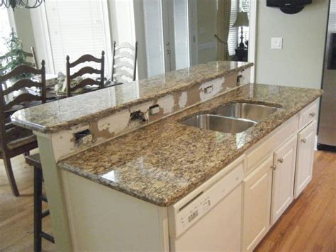 santa cecilia granite with white cabinets indelink