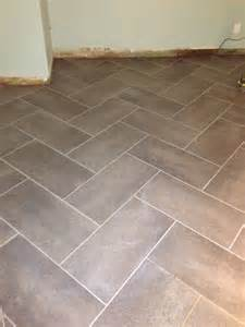 12 in x 24 in coastal grey resilient vinyl tile flooring 30 sq ft herringbone