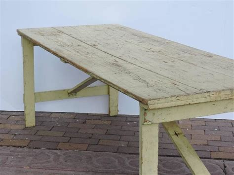 collapsible leg rustic farm table in pale yellow paint