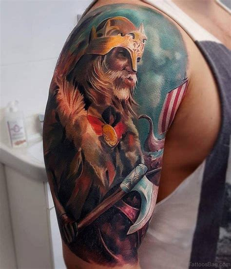 magnifying viking tribal shoulder tattoos