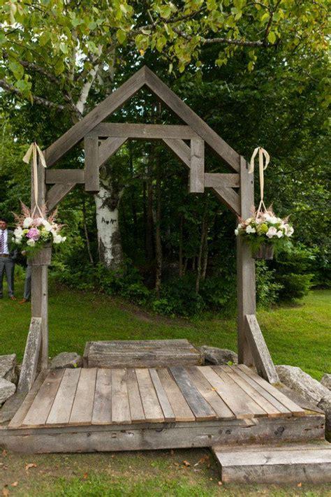 summer barn wedding   england wedding arbor rustic