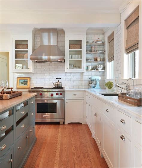 kitchen cabinets with different color island white cabinets with silver clamshell pulls different