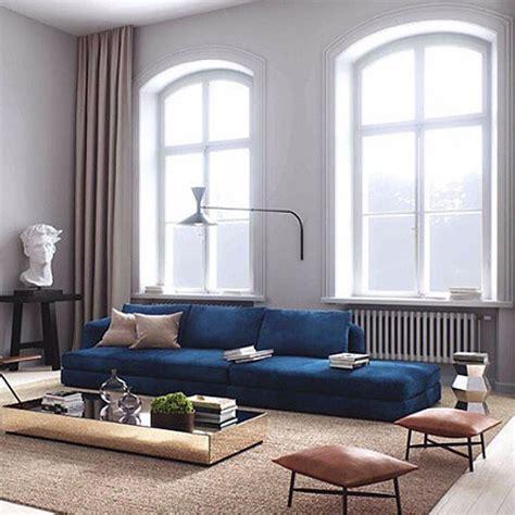 dark blue sofa living room reflective surfaces ivanhoe pinterest living rooms room