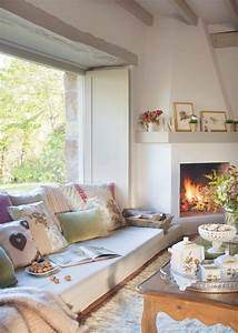 cozy living room with fireplace and low sofa under window ...