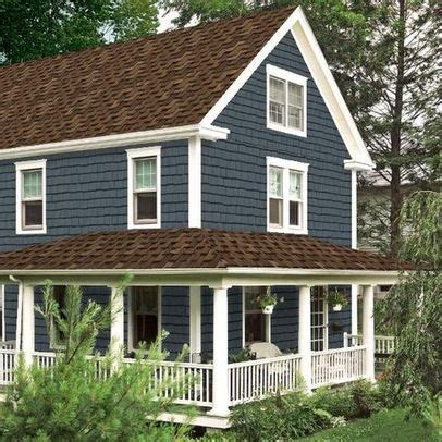 brown roof blue siding white trim house remodel