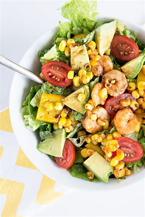 This chopped thai shrimp salad is loaded with veggies and tossed with a homemade garlic lime herb dressing. Some Like It Hot {Spicy Shrimp and Avocado Salad} - Dine and Dish