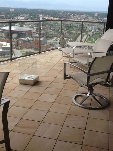 sandstone interlocking deck tile on apartment balcony