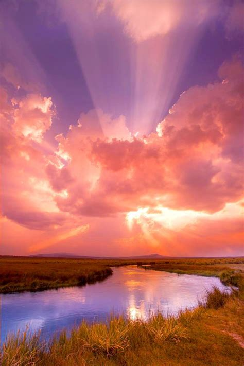 sunset sunrise sunbeams creek clouds water reflections mother
