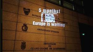 guerilla activists light up malta39s german embassy calling With justice light up letters