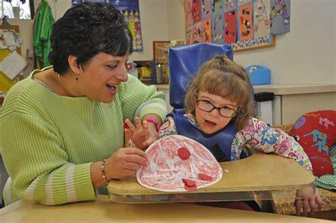 augustin children s center 221 | Preschool teacher and child smaller