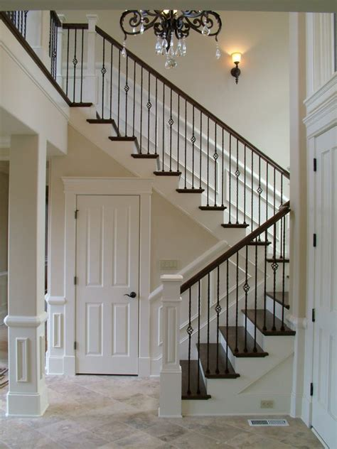 metal banister iron balusters plus smaller newell posts with larger newell at entrance plus like the trim on