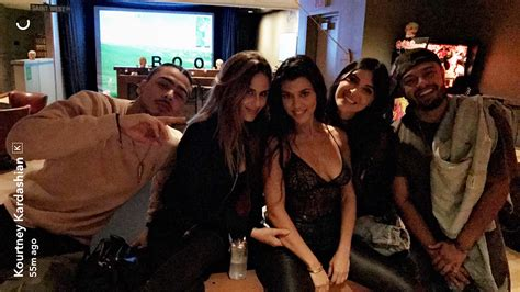 attends kanye west s show with kourtney
