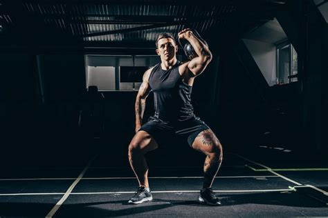 kettlebell thruster lifting sportsman testosterone depositphotos royalty lunges