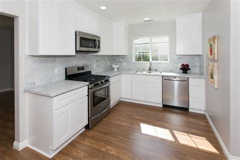 gray kitchen cabinets with stainless steel appliances beautiful warm wood floors white cabinets stainless
