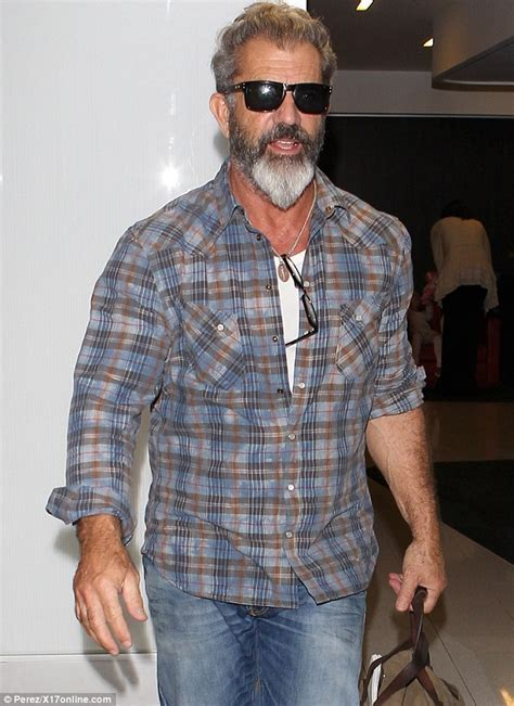 Mel Gibson shows off scruffy plaid shirt and grizzly grey