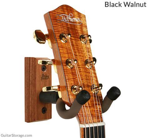 guitar wall hanger the string swing 174 wall mounted guitar hanger guitar storage 1521