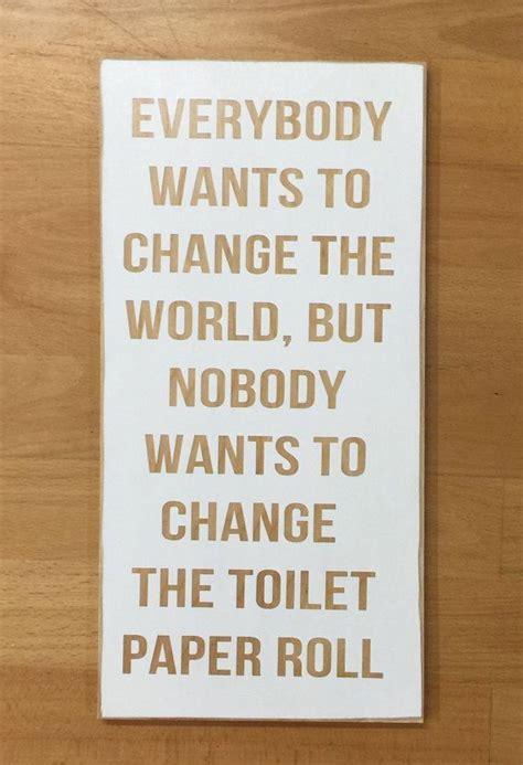 change  world change  toilet paper bathroom sign