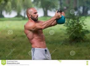 swing kettlebell outdoors workout exercise fitness muscular adult