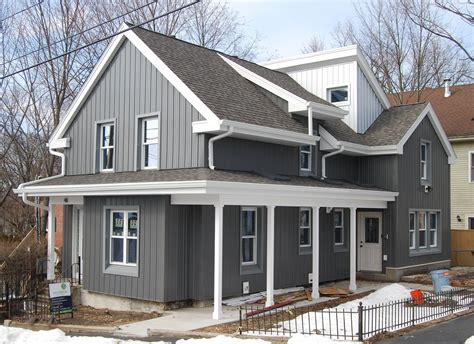 The Boldness Of The Metal Siding Is Softened By The Muted
