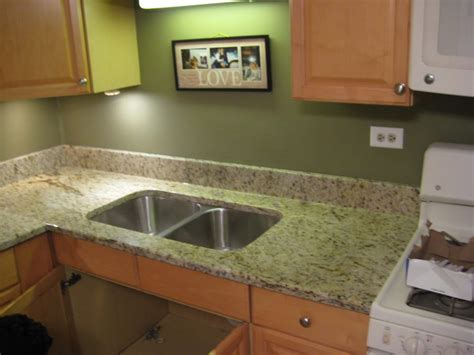 giallo ornamental kitchen fabricated and installed by