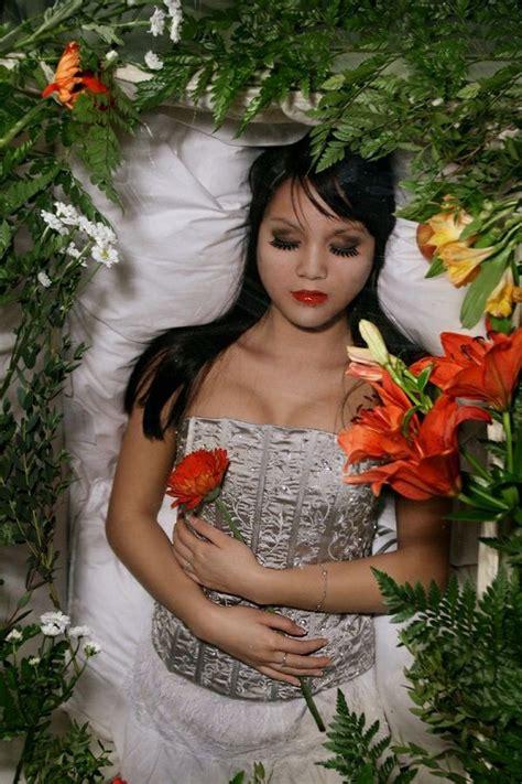 Casket girls, new orleans, la. Woman in her open casket at a fantasy funeral.   Women ...
