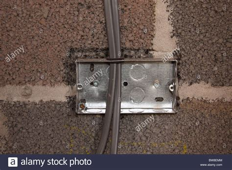 electrical light switch box during installation on a block