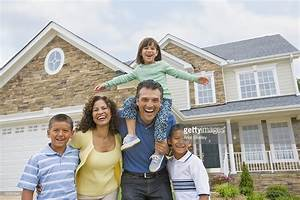 Hispanic Family In Front Of House Stock Photo | Getty Images