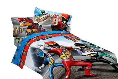 a bedroom with a power rangers bedding