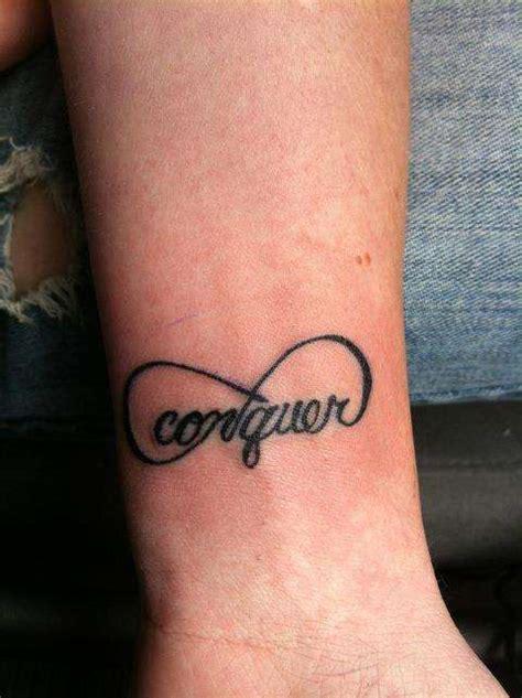 conquer tattoo