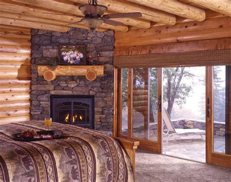 nice log cabin bedroom   fireplace