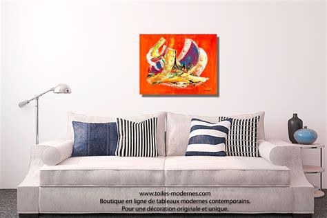 canapé bois et chiffon prix tableau orange abstrait format horizontal pour décoration