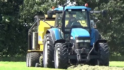 new holland tm 115 met ronde balen pers met wikkelaar youtube