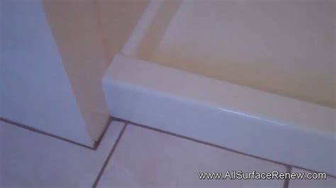 stained shower floor to be refinished to a easy to