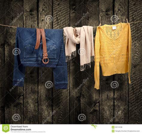 womens clothing   clothesline  wood background