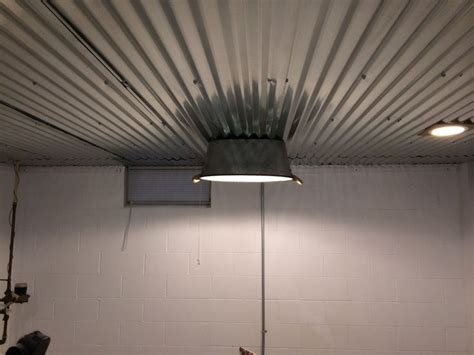 clever light fixture  corrugated steel ceiling