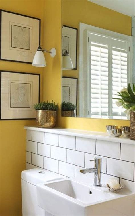 small bathroom  yellow wall colors  houseplants
