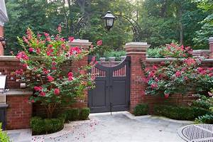 Wood driveway gates landscape traditional with red brick ...