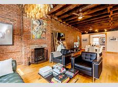 A 32Foot Long Living Room with Exposed Brick Dominates